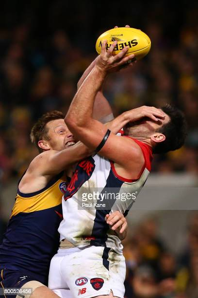 Cameron Pedersen of the Demons marks the ball against Sam Mitchell of the Eagles during the round 14 AFL match between the West Coast Eagles and the...