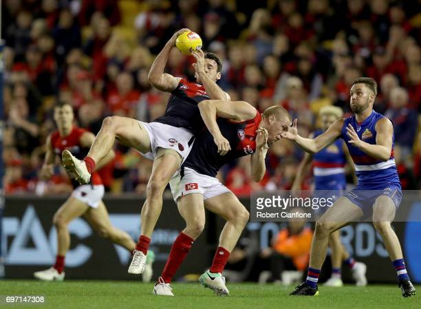 Cameron Pedersen of the Demons takes the ball over team mate Tom McDonald during the round 13 AFL match between the Western Bulldogs and the...