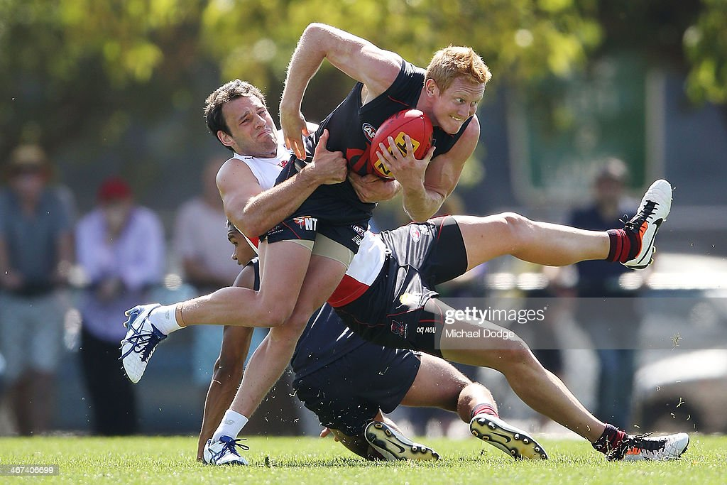 Cameron Pedersen tackles Jordie McKenzie during a Melbourne Demons AFL training session at Gosch's Paddock on February 7, 2014 in Melbourne, Australia.