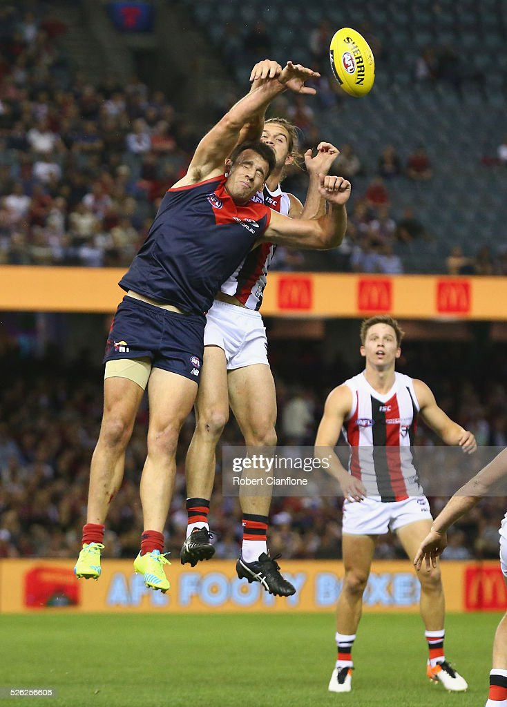 Cameron Pederson of the Demons is challenged by Josh Bruce of the Saints during the round six AFL match between the Melbourne Demons and the St Kilda Saints at Etihad Stadium on April 30, 2016 in Melbourne, Australia.