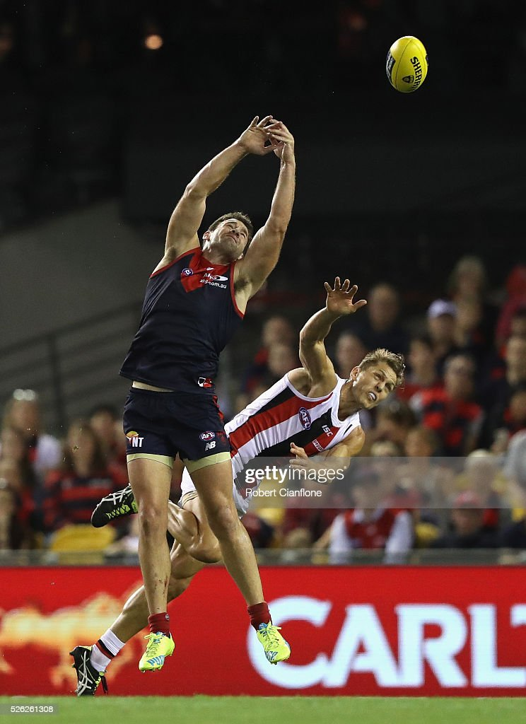 Cameron Pederson of the Demons is challenged by Sean Dempster of the Saints during the round six AFL match between the Melbourne Demons and the St Kilda Saints at Etihad Stadium on April 30, 2016 in Melbourne, Australia.