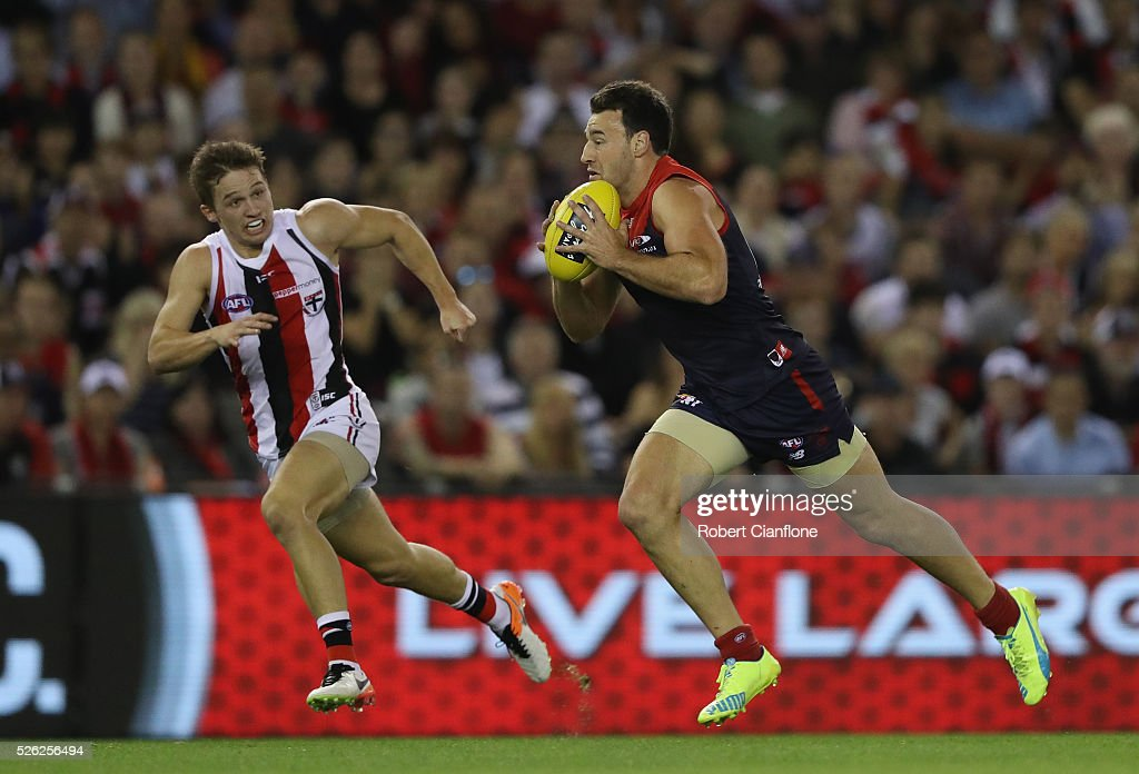Cameron Pederson of the Demons runs with the ball during the round six AFL match between the Melbourne Demons and the St Kilda Saints at Etihad Stadium on April 30, 2016 in Melbourne, Australia.