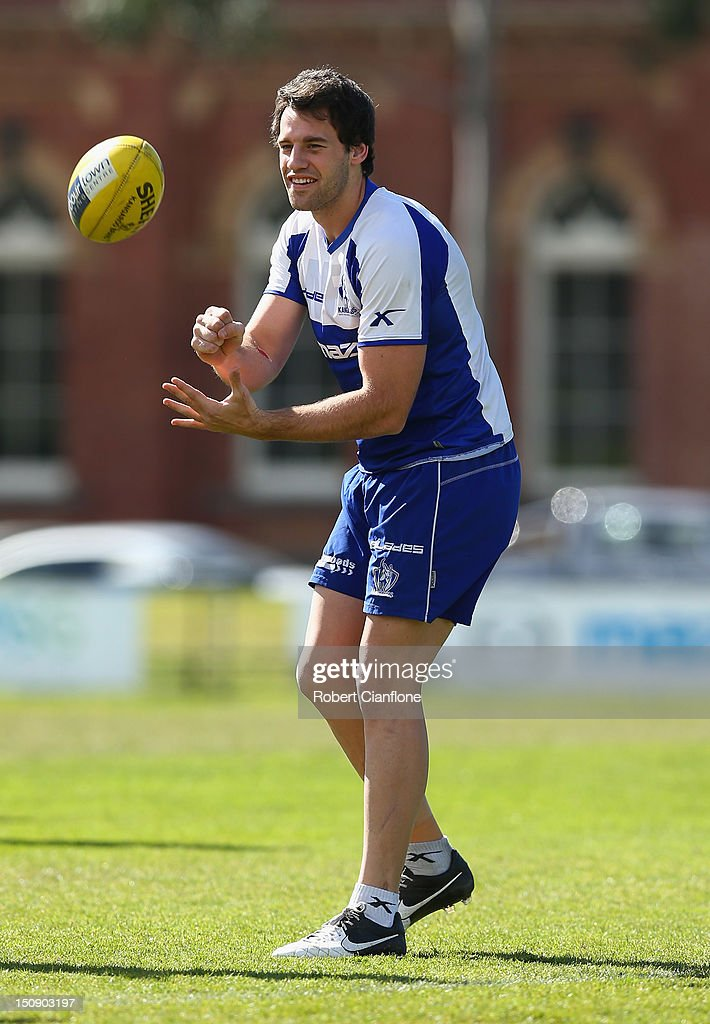 Cameron Pederson of the Kangaroos handballs during a training session at Aegis Park on August 29, 2012 in Melbourne, Australia.