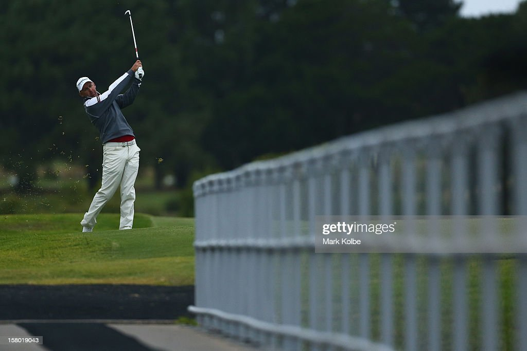Cameron Percy of Australia plays a fairway shot during round four of the 2012 Australian Open at The Lakes Golf Club on December 9, 2012 in Sydney, Australia.
