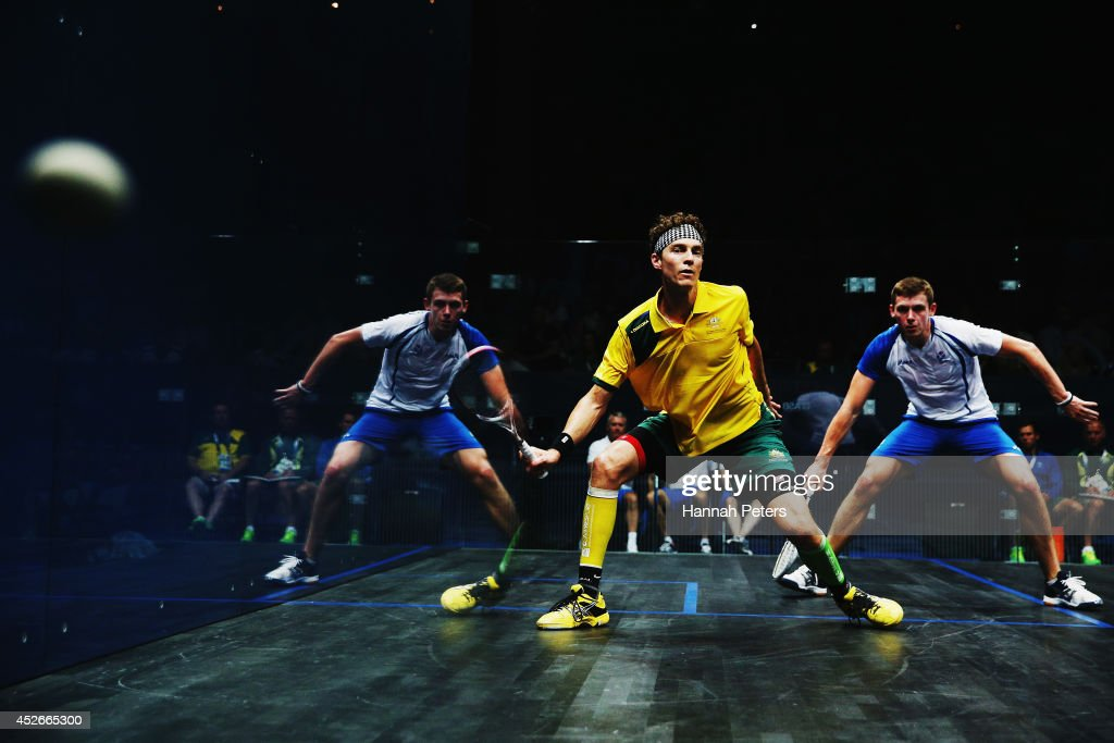 Cameron Pilley of Australia competes against Greg Lobban of Scotland in the Men's singles round 16 squash match at Scotstoun Sports Campus during day two of the Glasgow 2014 Commonwealth Games on July 25, 2014 in Glasgow, United Kingdom.