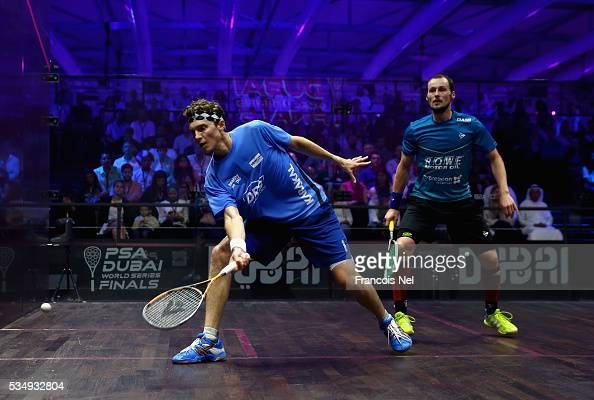 Cameron Pilley of Australia competes against Gregory Gaultier of France during the men's final match of the PSA Dubai World Series Finals 2016 at...