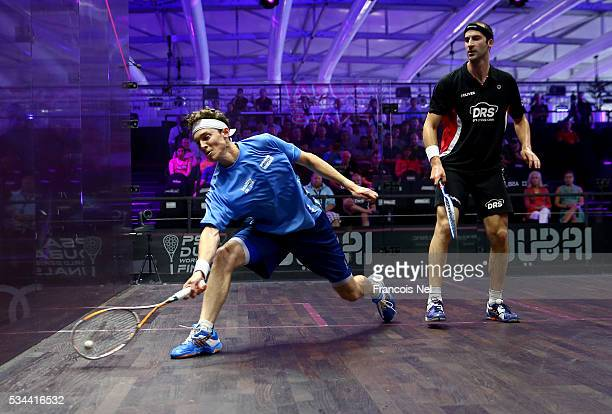 Cameron Pilley of Australia competes against Simon Rosner of Germanyduring day three of the PSA Dubai World Series Finals 2016 at Burj Park on May 26...