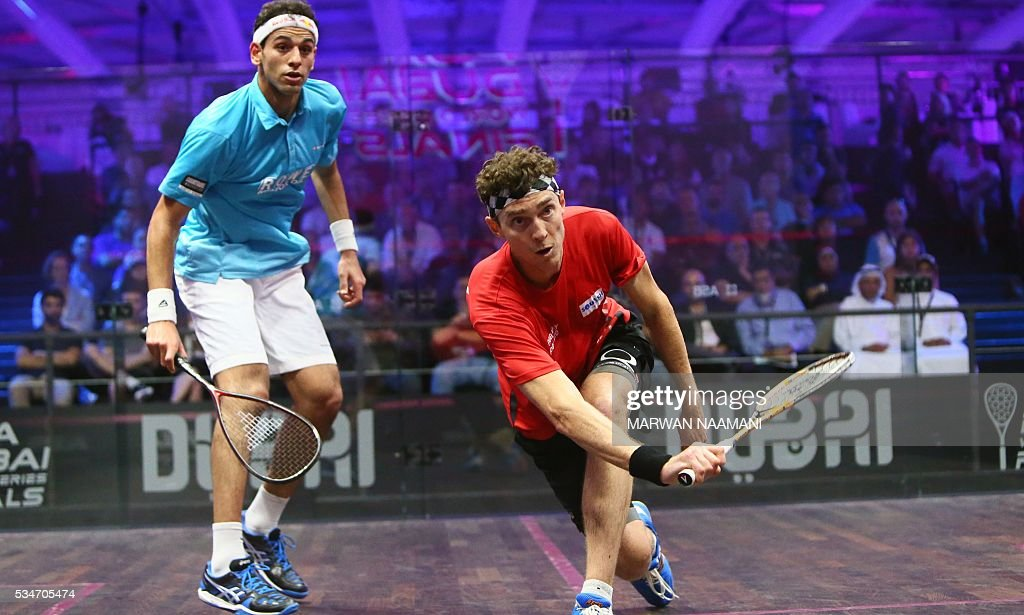 Cameron Pilley of Australia (R) plays a forehand to Mohamed El Shorbagy of Egypt during their semi-final match of the Dubai PSA World Series Finals squash tournament in Dubai on May 27, 2016. NAAMANI