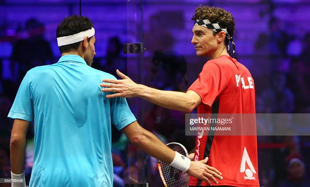 Cameron Pilley of Australia (R) salutes Mohamed El Shorbagy of Egypt following his win during their semi-final match of the Dubai PSA World Series Finals squash tournament in Dubai on May 27, 2016. NAAMANI