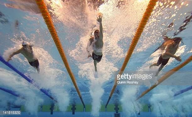 Cameron Prosser James Magnussen and Matthew Abood of Australia compete in the Heats of the Men's 100 Metre Freestyle during day four of the...
