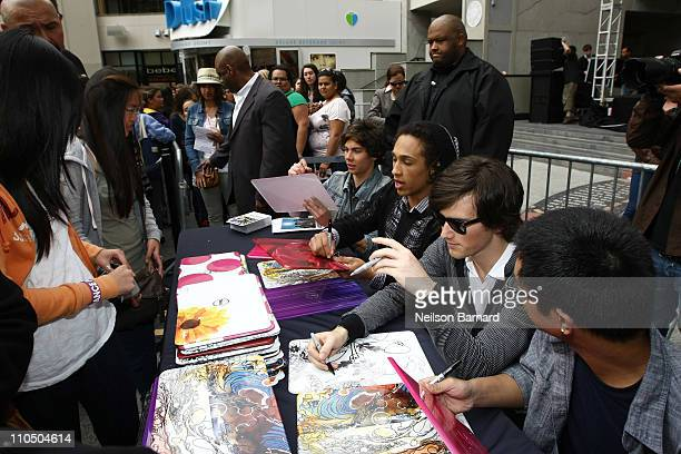 Cameron Quiseng Nathan Darmody Zachary Porter and Michael Martinez of Allstar Weekend sign autographs for fans at Dell's SWITCH by Design Studio...