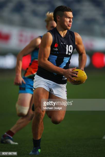 Cameron Rayner of Vic Metro runs with the ball during the U18 AFL Championships match between Vic Metro and the Allies at Simonds Stadium on July 5...
