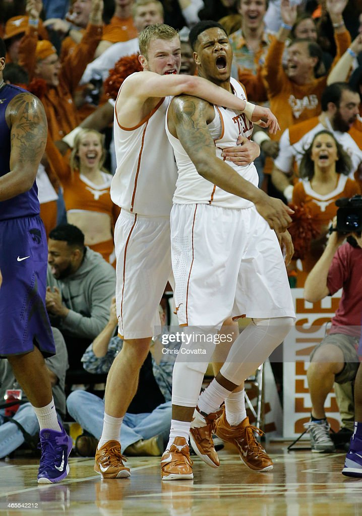 Cameron Ridley #55 and Connor Lammert #21 of the Texas Longhorns react after Ridley's slam dunk against the Kansas State Wildcats at the Frank Erwin Center on March 2, 2015 in Austin, Texas.