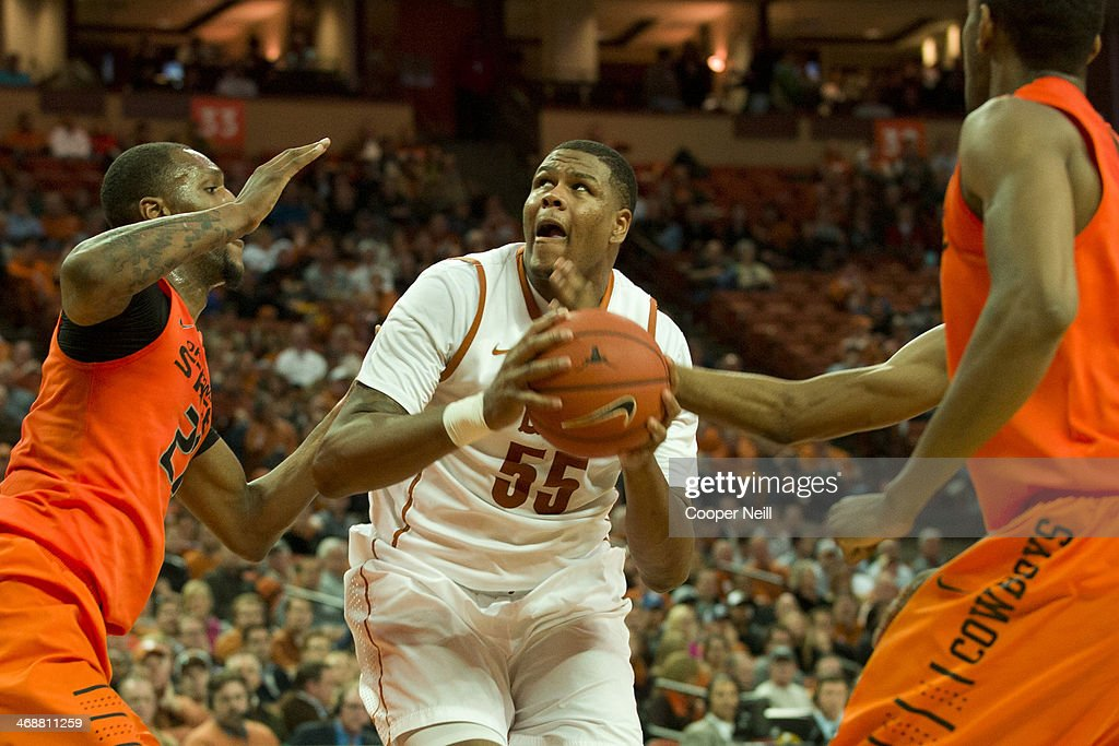 Cameron Ridley #55 of the Texas Longhorns drives to the basket against the Oklahoma State Cowboys on February 11, 2014 at the Frank Erwin Center in Austin, Texas.