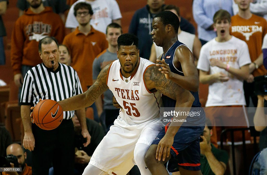 Cameron Ridley #55 of the Texas Longhorns moves with the ball against A.J. Cockrell #33 of the Texas-San Antonio Roadrunners at the Frank Erwin Center on December 8, 2015 in Austin, Texas.