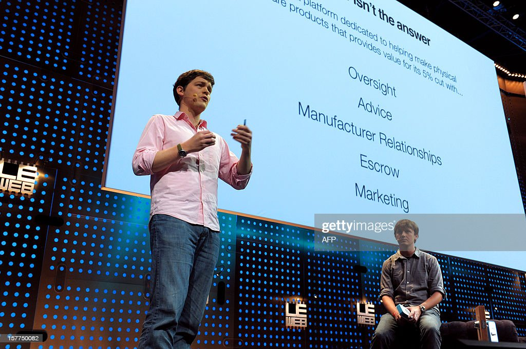 US Cameron Robertson (L) and Paul Gerhardt, Co-Founders of Apigy Inc. present their product 'Lockitron,' a keyless entry using smartphone, during LeWeb'12 in Saint-Denis, near Paris on December 6, 2012. AFP PHOTO ERIC PIERMONT