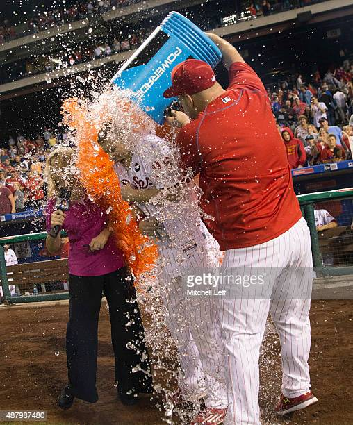 Cameron Rupp and Ken Giles of the Philadelphia Phillies dump Powerade on Cody Asche after Asche hit a walkoff tworun home run in the bottom of the...