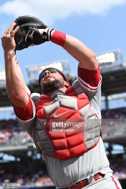 Cameron Rupp of the Philadelphia Phillies catches a foul ball during the game against the Washington Nationals at Nationals Park on April 16 2017 in...