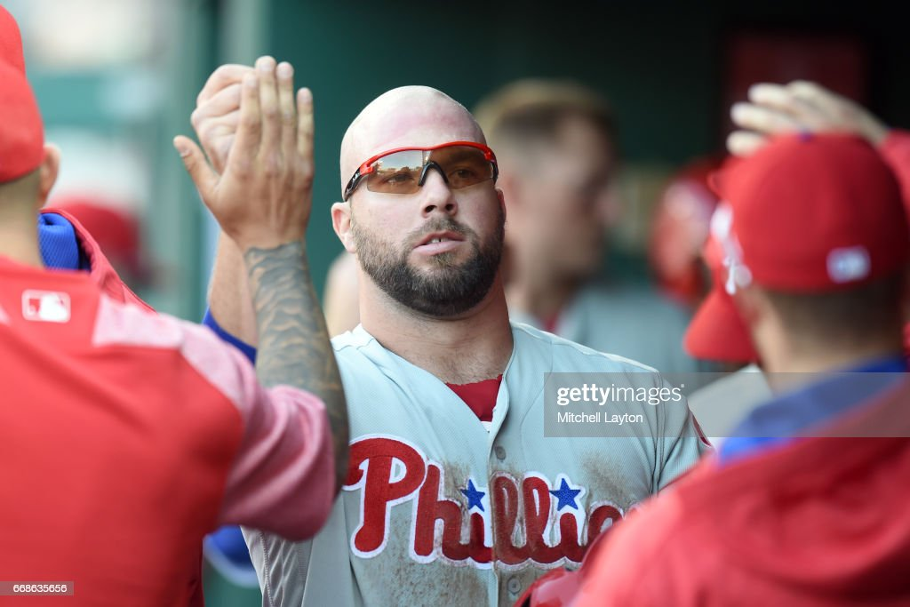 Cameron Rupp #29 of the Philadelphia Phillies celebrates scoring a run on a Cesar Hernandez #16 (not pictured) hit in the fifth inning during a baseball game against the Washington Nationals at Nationals Park on April 14, 2017 in Washington, D.C. The Nationals won 3-2 in ten innings.