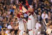 Cameron Rupp of the Philadelphia Phillies celebrates with Andres Blanco after hitting a two run home run in the ninth inning during the game against...