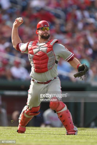 Cameron Rupp of the Philadelphia Phillies fields a bunt during the game against the Washington Nationals at Nationals Park on April 16 2017 in...