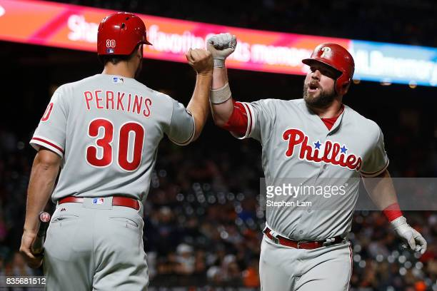 Cameron Rupp of the Philadelphia Phillies high fives teammate Cameron Perkins after hitting a solo home run during the ninth inning against the San...