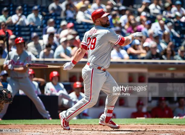 Cameron Rupp of the Philadelphia Phillies hits a double during the third inning of a baseball game against the San Diego Padres at PETCO Park on...