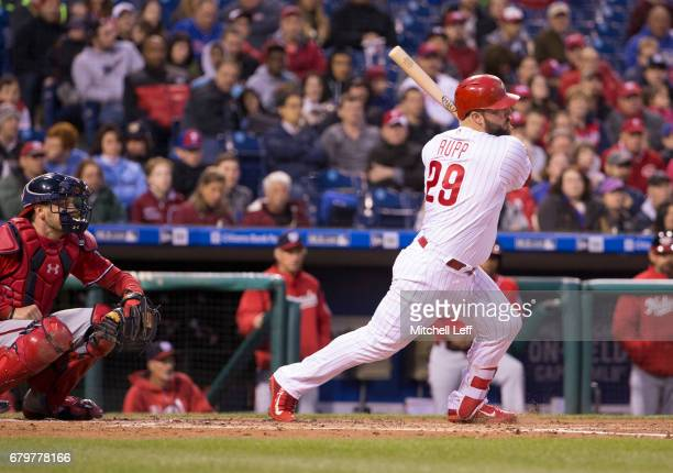 Cameron Rupp of the Philadelphia Phillies hits an RBI single in the bottom of the second inning against the Washington Nationals at Citizens Bank...