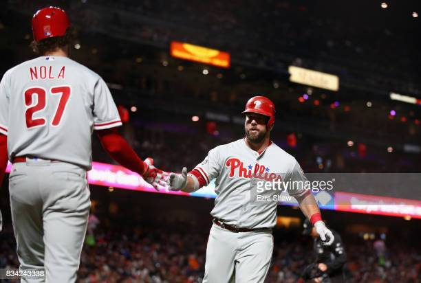 Cameron Rupp of the Philadelphia Phillies is congratulated by Aaron Nola after he hit a home run in the fifth inning against the San Francisco Giants...