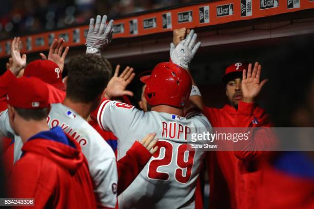 Cameron Rupp of the Philadelphia Phillies is congratulated by teammates after he hit a home run in the fifth inning against the San Francisco Giants...