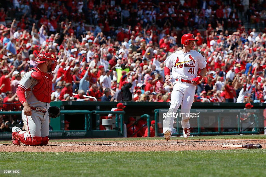 Cameron Rupp #29 of the Philadelphia Phillies looks on as Jeremy Hazelbaker #41 of the St. Louis Cardinals scores a run during the seventh inning at Busch Stadium on May 5, 2016 in St. Louis, Missouri.