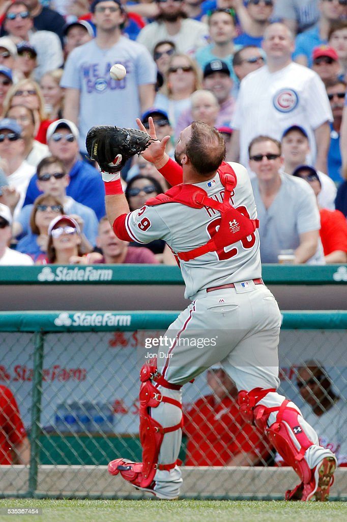 Vince Velasquez #28 of the Philadelphia Phillies makes a catch for an out in foul territory against the Chicago Cubs during the second inning at Wrigley Field on May 29, 2016 in Chicago, Illinois.