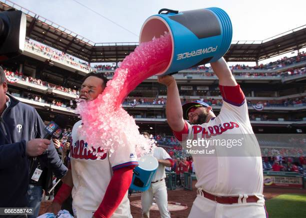 Cameron Rupp of the Philadelphia Phillies pours Powerade on Cesar Hernandez of the Philadelphia Phillies after Hernandez hit a walk off single in the...