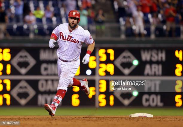 Cameron Rupp of the Philadelphia Phillies rounds the bases after hitting a threerun home run in the eighth inning during a game against the Milwaukee...