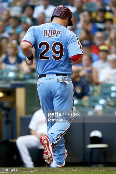 Cameron Rupp of the Philadelphia Phillies scores a run in the fifth inning against the Milwaukee Brewers at Miller Park on July 15 2017 in Milwaukee...