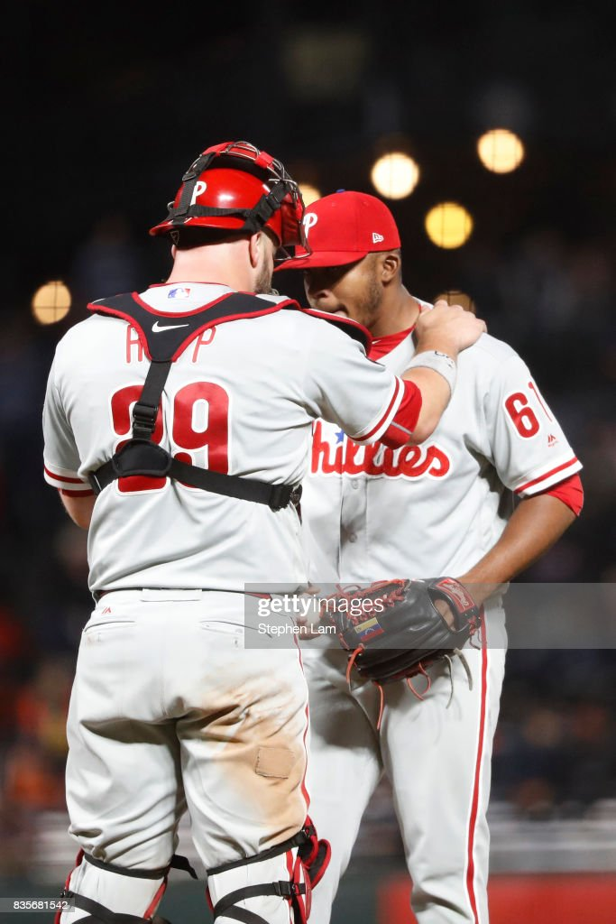 Cameron Rupp #29 of the Philadelphia Phillies speaks with pitcher Edubray Ramos #61 during the ninth inning against the San Francisco Giants at AT&T Park on August 19, 2017 in San Francisco, California.