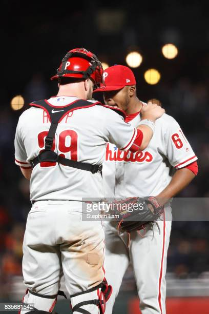 Cameron Rupp of the Philadelphia Phillies speaks with pitcher Edubray Ramos during the ninth inning against the San Francisco Giants at ATT Park on...