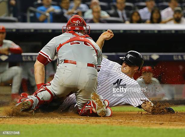 Cameron Rupp of the Philadelphia Phillies tags out Brett Gardner of the New York Yankees at the plate in the sixth inning during their game at Yankee...