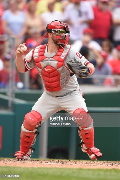 Cameron Rupp of the Philadelphia Phillies throws to second base during the game against the Washington Nationals at Nationals Park on April 16 2017...