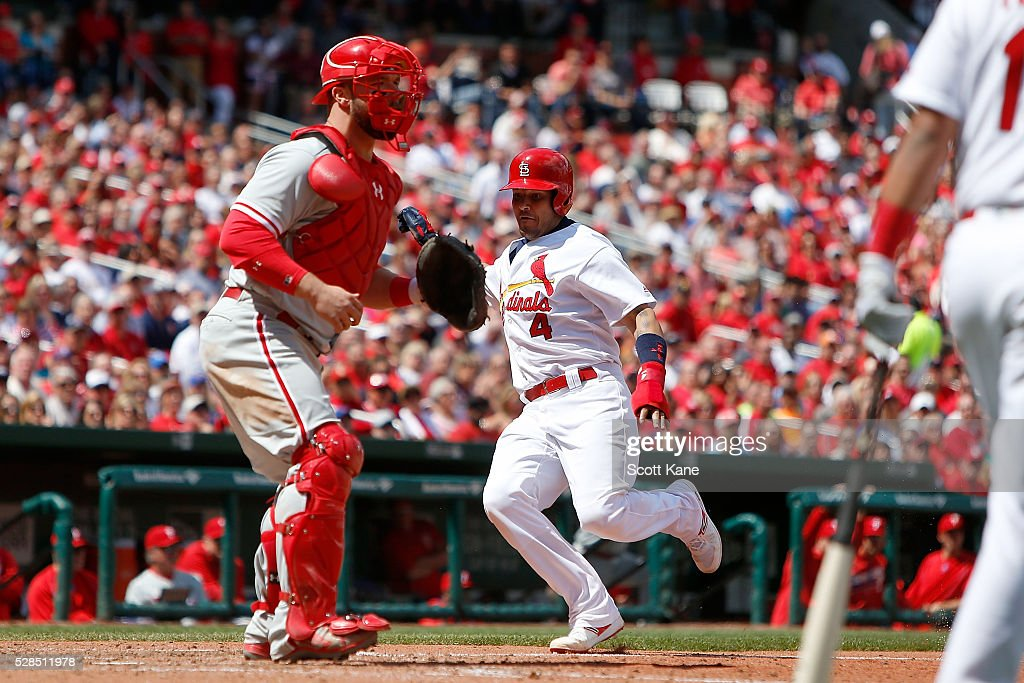 Cameron Rupp #29 of the Philadelphia Phillies waits for the ball as Yadier Molina #4 of the St. Louis Cardinals prepares to slide home to score a run during the seventh inning at Busch Stadium on May 5, 2016 in St. Louis, Missouri.