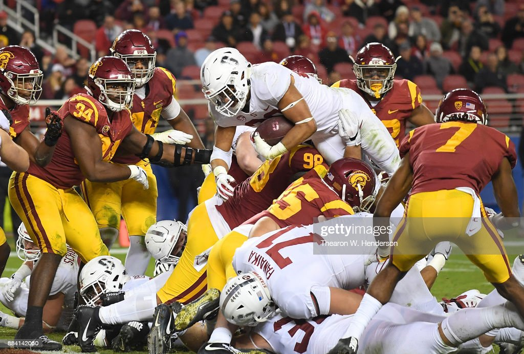 Cameron Scarlett #22 of the Stanford Cardinal dives but comes up a yard short of the goal line against the USC Trojans during the Pac-12 Football Championship Game at Levi's Stadium on December 1, 2017 in Santa Clara, California.