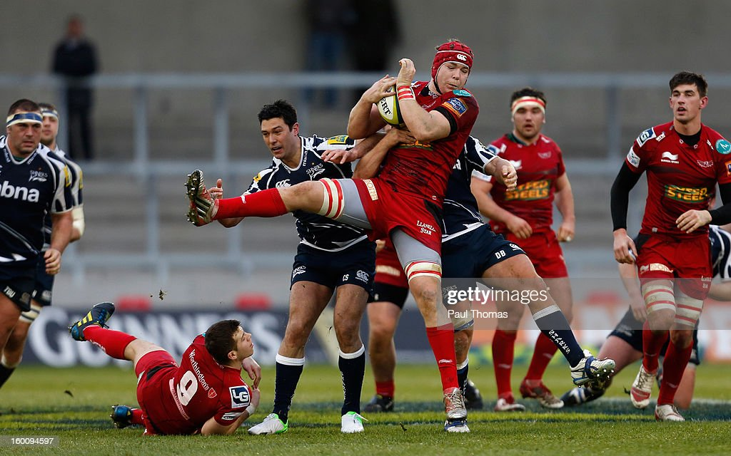 Cameron Shepherd (3rd L) of Sale Sharks in action with Kiernan Murphy (C) of Scarlets during the LV= Cup match between Sale Sharks and Scarlets at Salford City Stadium on January 26, 2013 in Salford, England.