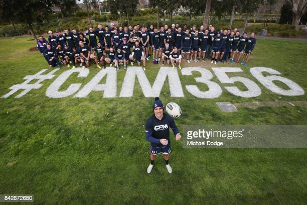 Cameron Smith about to play his record breaking 356th match pose with teammates during a Melbourne Storm NRL training session at AAMI Park on...