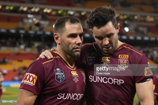 Cameron Smith and Aidan Guerra of the Maroons looks on after losing game one of the State Of Origin series between the Queensland Maroons and the New...