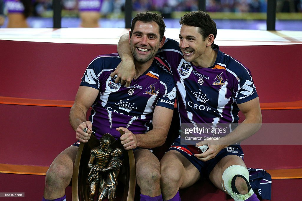 <a gi-track='captionPersonalityLinkClicked' href=/galleries/search?phrase=Cameron+Smith+-+Rugby+League+Player&family=editorial&specificpeople=453295 ng-click='$event.stopPropagation()'>Cameron Smith</a> and <a gi-track='captionPersonalityLinkClicked' href=/galleries/search?phrase=Billy+Slater&family=editorial&specificpeople=171206 ng-click='$event.stopPropagation()'>Billy Slater</a> of the Storm celebrate on the podium after winning the 2012 NRL Grand Final match between the Melbourne Storm and the Canterbury Bulldogs at ANZ Stadium on September 30, 2012 in Sydney, Australia.