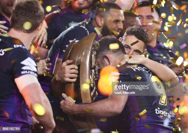 Cameron Smith and Billy Slater of the Storm celebrate with the NRL Premiership trophy after winning the 2017 NRL Grand Final match between the...