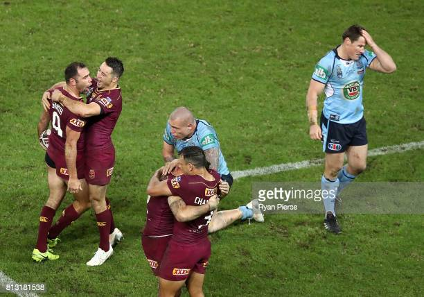 Cameron Smith and Cooper Cronk of the Maroons celebrate victory during game three of the State Of Origin series between the Queensland Maroons and...