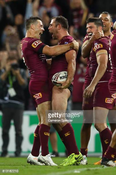 Cameron Smith and Cooper Cronk of the Maroons celebrate winning game three of the State Of Origin series between the Queensland Maroons and the New...
