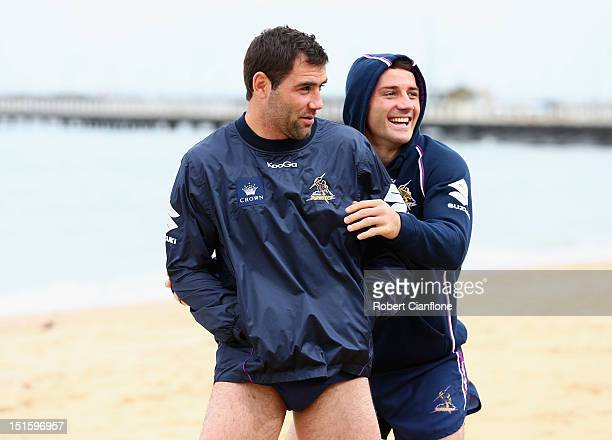 Cameron Smith and Cooper Cronk of the Strom fool around during a Melbourne Storm recovery session at St Kilda Sea Baths on September 9 2012 in...