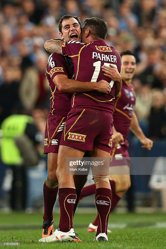 Cameron Smith and Corey Parker of the Maroons celebrate winning game three of the ARL State of Origin series between the New South Wales Blues and the Queensland Maroons at ANZ Stadium on July 17, 2013 in Sydney, Australia.